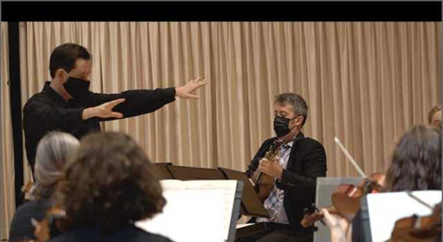 """Lowell Chamber Orchestra music director Orlando Cela (left), and mandolinist Joseph Brent (right). Photo by Adam Noya"